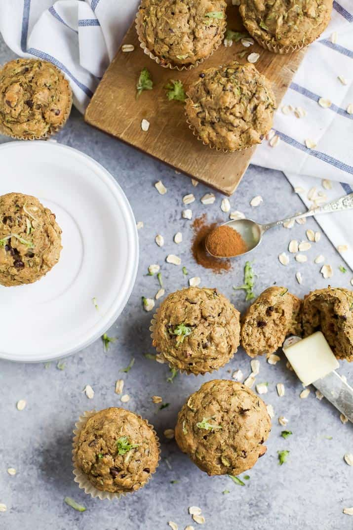 Top view of Chocolate Chip Zucchini Muffins on a plate, cutting board, and countertop