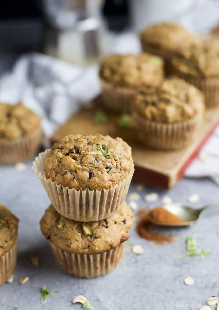Chocolate Chip Zucchini Muffins stacked on a countertop