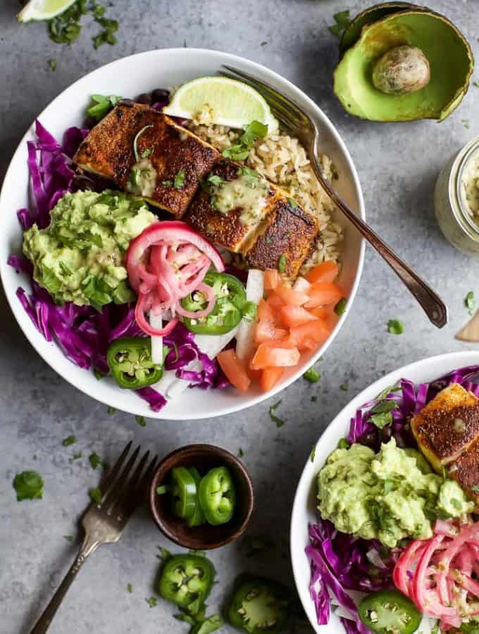 FISH TACO RICE BOWLS with avocado and pickled onions, topped with a Cilantro Lime Dressing! The perfect 30 minute meal to satisfy even the pickiest of eaters!   joyfulhealthyeats.com   Gluten Free Recipes
