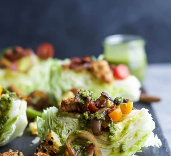 SOUTHWESTERN WEDGE SALAD with seasoned chicken, bacon, onion rings, charred corn a POBLANO DRESSING you'll adore. The wedge salad only takes 30 minutes to make & is under 400 calories a serving! | joyfulhealthyeats.com | Gluten Free Recipes