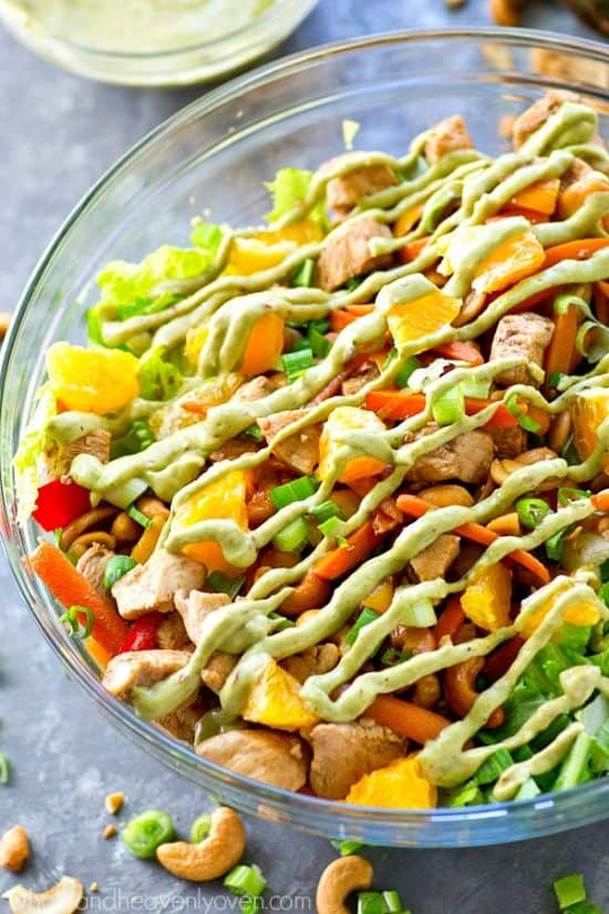 Love cashew chicken? You're going to love it even more in super-healthy Cashew Chicken salad form with an insane kicked-up chipotle avocado dressing drizzled on top!
