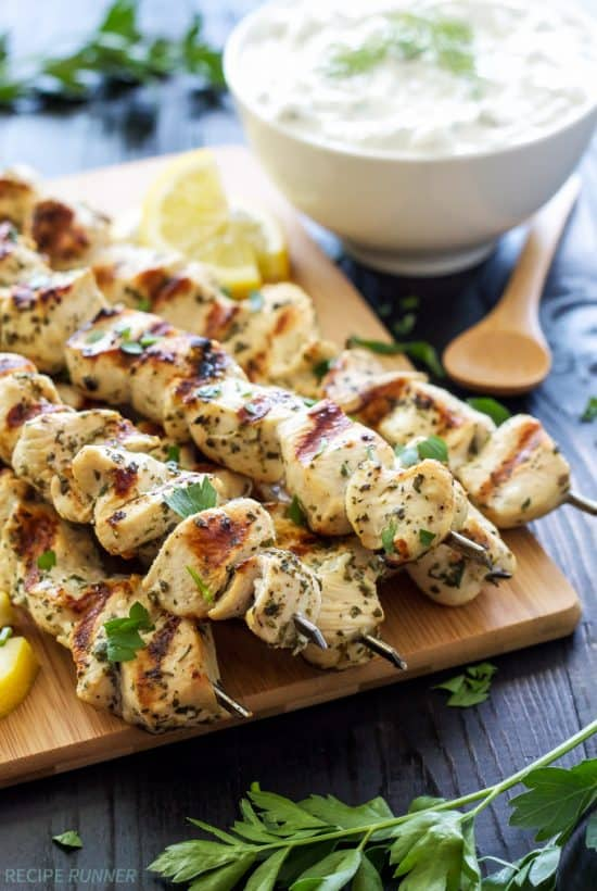 Lemon, garlic, oregano, and parsley add amazing flavor to these chicken skewers! Serve them with healthy homemade tzatziki sauce for a delicious and easy to make meal!