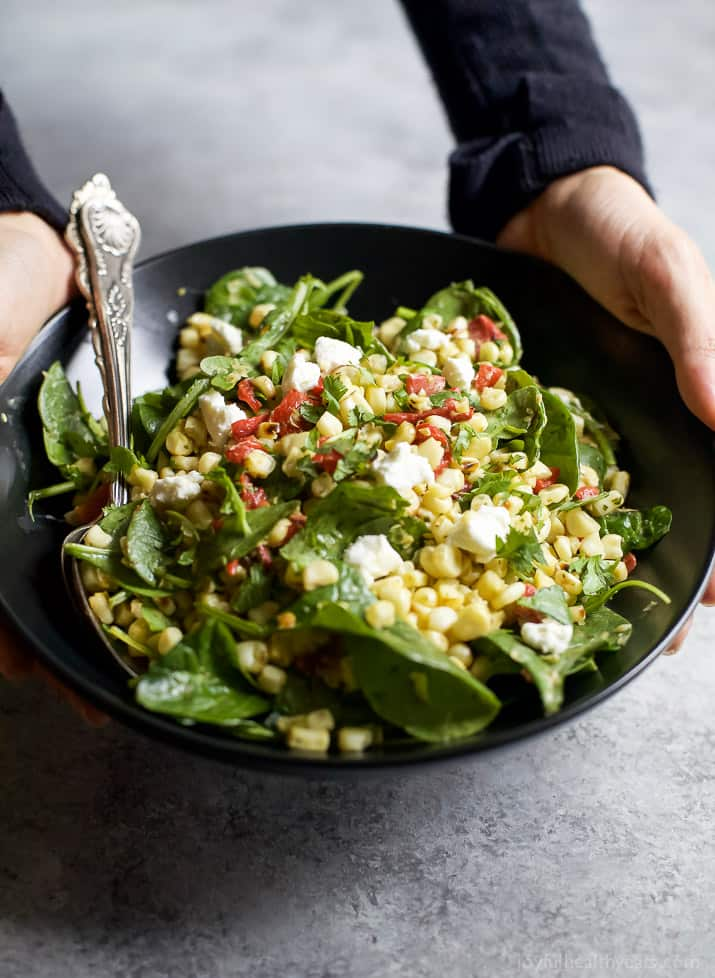 A simple healthy gluten free GRILLED CORN SALAD filled with fresh greens, roasted red pepper, and goat cheese then tossed with a spicy JALAPENO DRESSING. This Corn Salad is the ultimate side dish of the summer! | joyfulhealthyeats.com