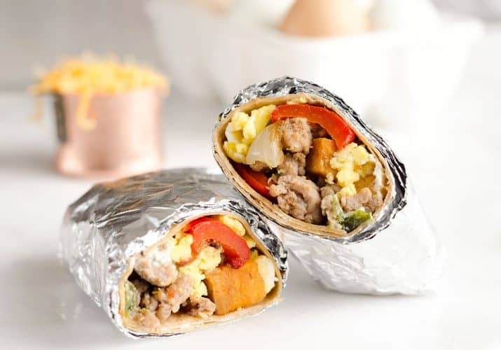 Light & Spicy Turkey Sausage Breakfast Burritos are a healthy freezer-friendly breakfast full of lean Jennie-O turkey sausage, scrambled eggs and roasted vegetables.