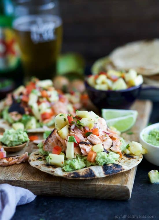 Pineapple Chipotle Salmon Tostadas - slightly charred smoky Salmon combined with Spicy Pineapple Salsa and creamy Avocados. These Tostadas take 30 minutes to make and are only 283 calories, a must make for a busy weeknight!