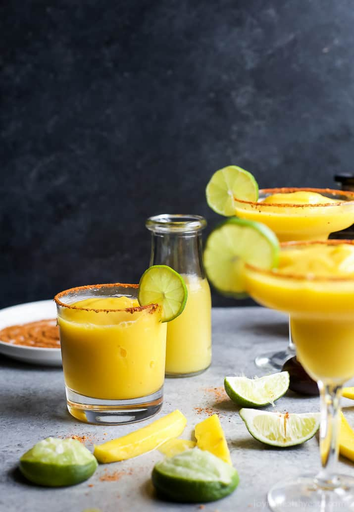 Glasses of Frozen Mango Margaritas with a chili lime salt rim