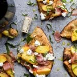 Image of Slices of Grilled Prosciutto Peach Flatbread Pizza