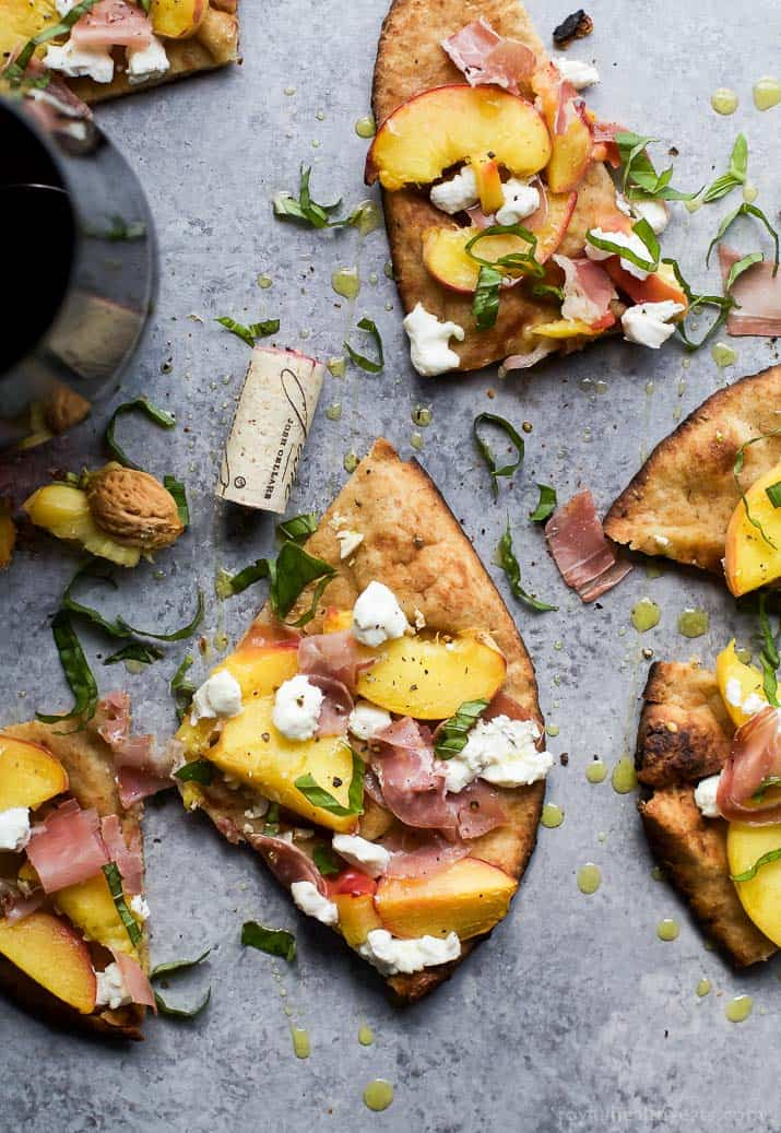 Grilled Flatbread Pizza topped with Peaches, Prosciutto, Goat Cheese, and fresh Basil! The ultimate summer grilling recipe done in just 30 minutes!