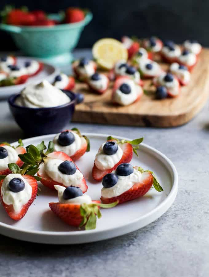 Patriotic Cheesecake Stuffed Strawberries - an easy healthy recipe that tastes like strawberry cheesecake but without all the calories!