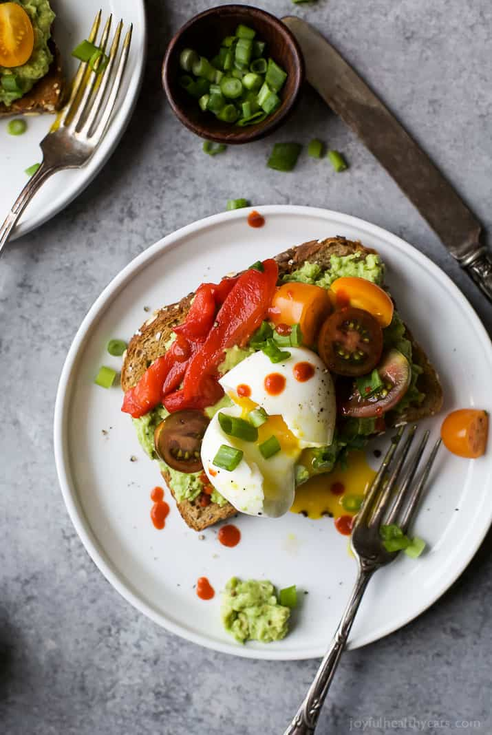 Smashed Avocado Toast topped with a perfectly cooked Soft Boiled Egg and fresh veggies. This is one Avocado Toast you'll devour! | vegetarian