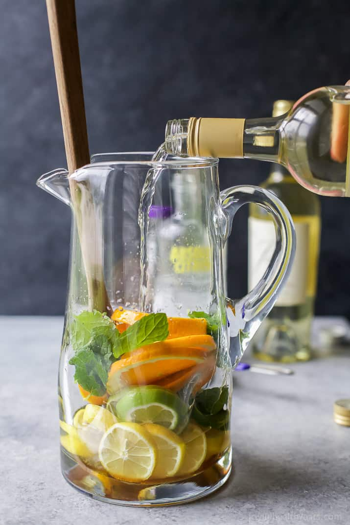 Easy Citrus White Wine Sangria with loads of citrus, white wine and citrus vodka. It's the perfect refreshing cocktail to sip on those hot summer days!