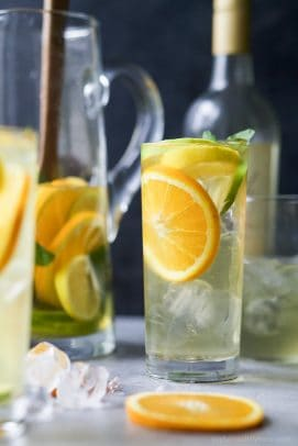 Citrus White Wine Sangria with an orange slice in a clear glass