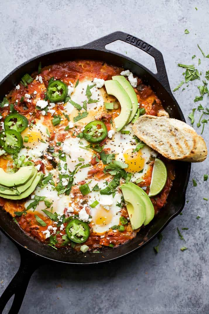 One Pot Mexican Shakshuka an easy dinner recipe made in 30 minutes only 206 calories a serving. Eggs baked in a spicy mexican inspired tomato sauce - it's egg-cellent!