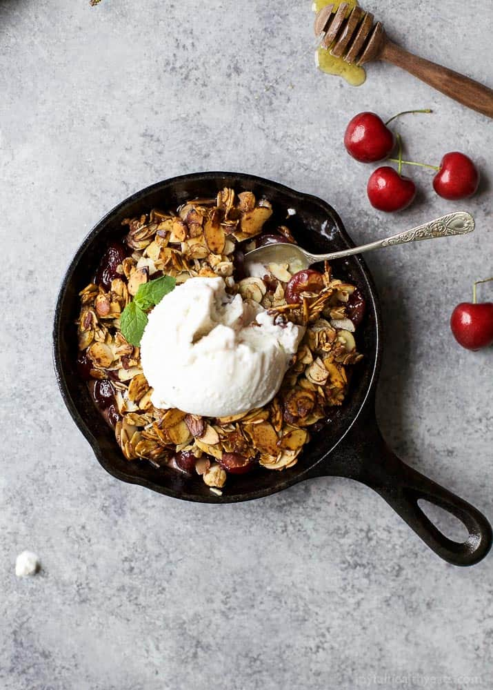 Gluten Free Cherry Crisp using fresh cherries, honey, and almonds! The ultimate HEALTHY cherry crisp recipe, the perfect dessert recipe for the spring and summer months! | #ad @simpletruth