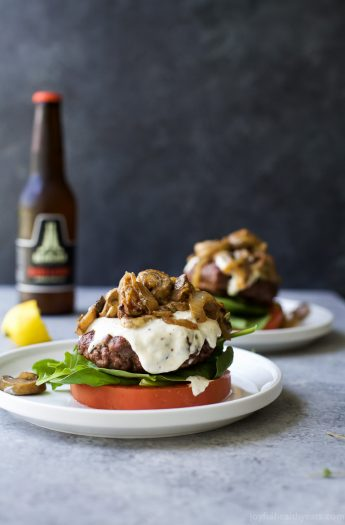 "Caramelized Onion & Mushroom Burgers served ""bunless"" and topped with a creamy Horseradish Aioli. A gluten free burger recipe you'll want all summer long! 