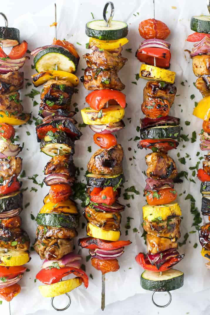 overhead photo balsamic grilled chicken kabobs garnished with parsley