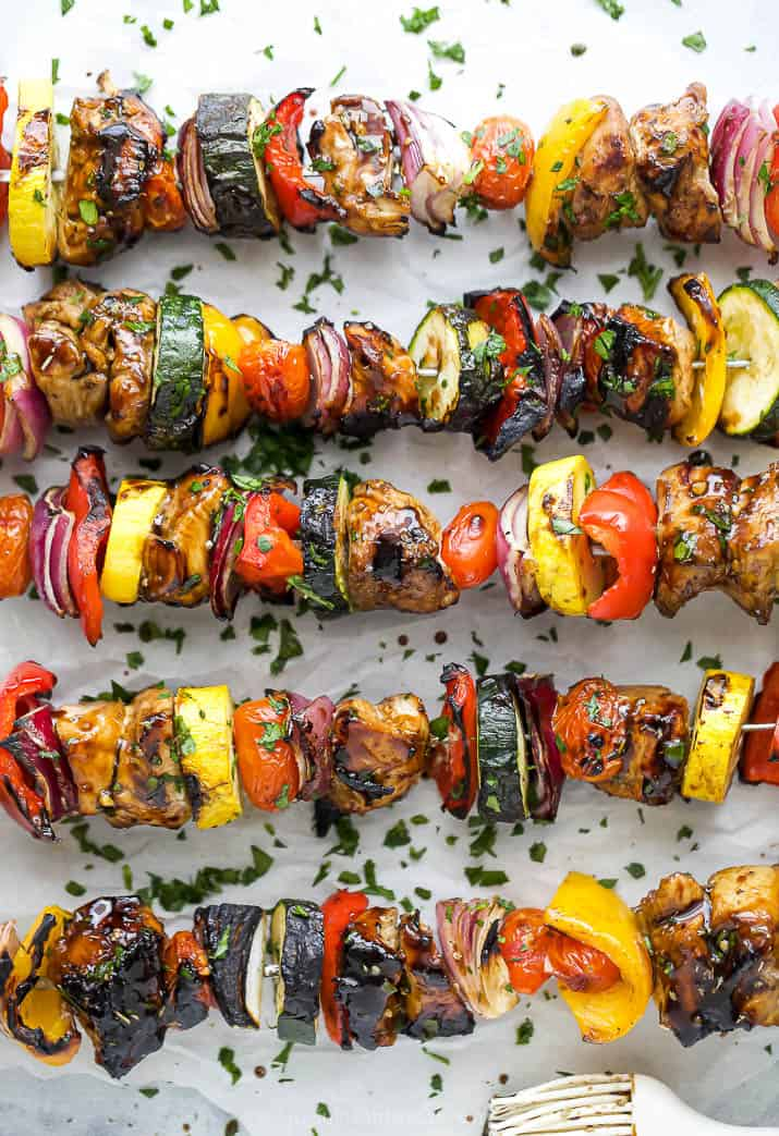 overhead photo of best ever balsamic grilled chicken kabobs garnished with parsley