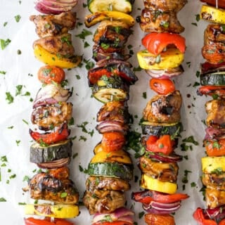 overhead photo of the best ever balsamic grilled chicken kabobs lying on a table