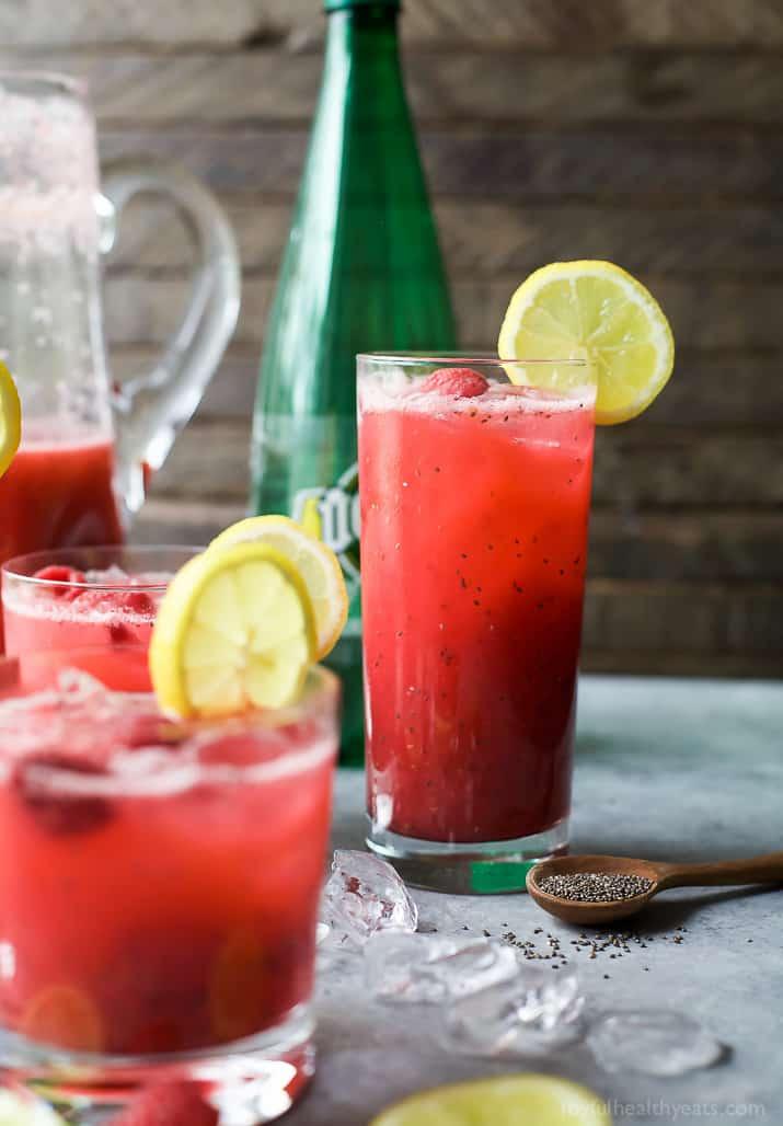 Glasses of Chia Raspberry Lemonade Spritzer with lemon slice garnish