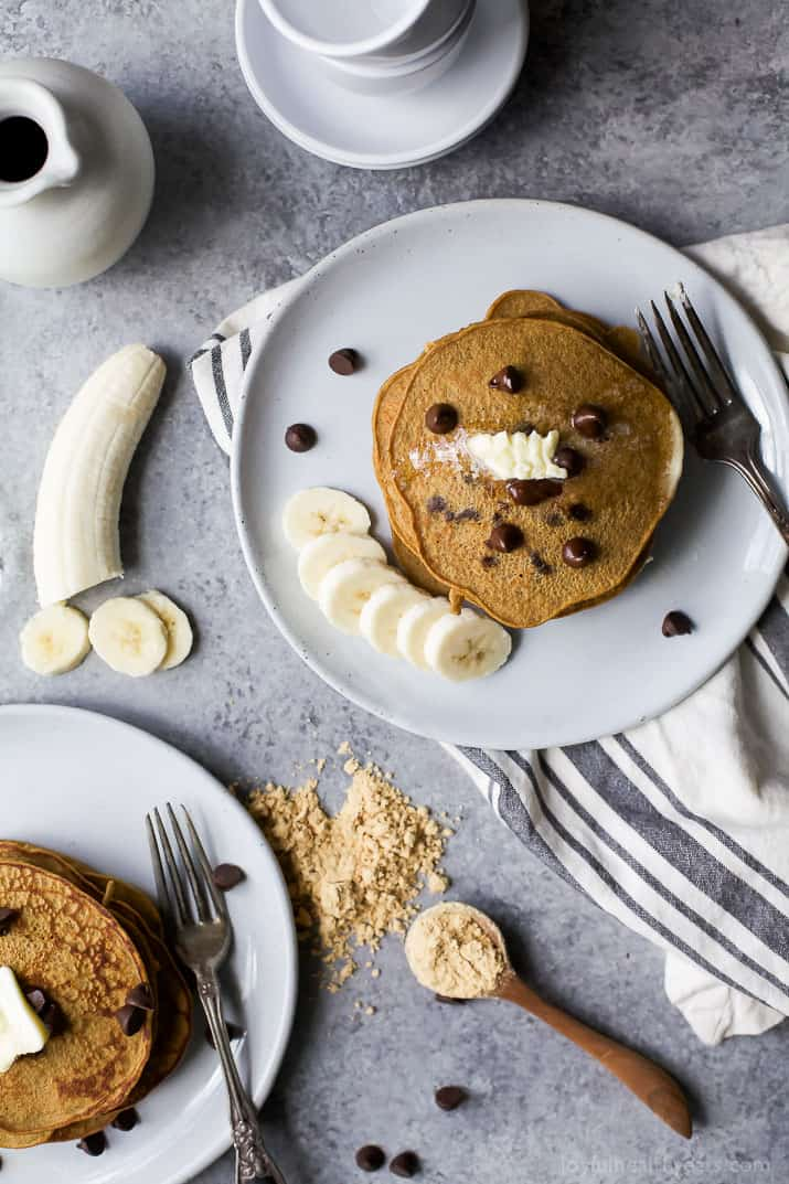 Top view of Flourless Peanut Chocolate Chip Pancakes on a plate with Bananas