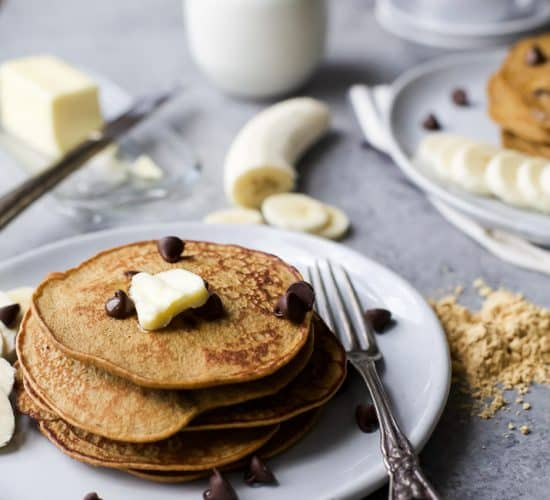 Flourless Peanut Chocolate Chip Pancakes made in the blender and only 290 calories. The perfect breakfast for Saturday mornings! Plus who can resist chocolate and peanut butter! | #ad | gluten free recipes