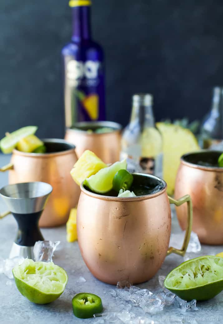 A Pineapple infused Moscow Mule topped with Jalapeno for a spicy kick. This refreshing sip will be your new favorite cocktail this summer!
