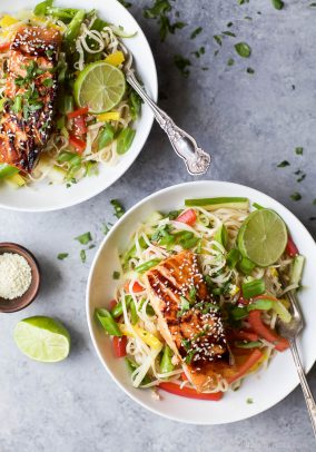 Two bowls of Easy Teriyaki Salmon served on a bed of Asian Noodles made with brown rice noodles, fresh veggies and a homemade Asian Sesame Dressing!   gluten free recipes