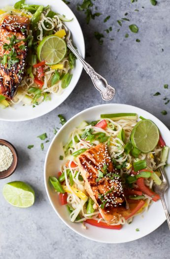 Easy Teriyaki Salmon served on a bed of Asian Noodles made with brown rice noodles, fresh veggies and a homemade Asian Sesame Dressing! A light, simple refreshing recipe for the summer! | gluten free recipes