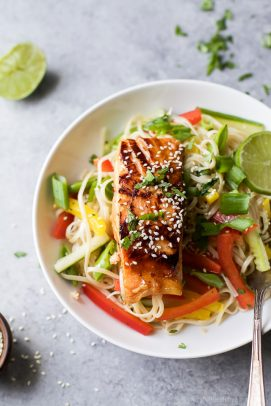 teriyaki salmon with asian noodle salad on a plate
