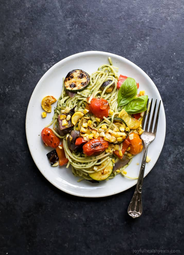 Basil Pesto Pasta tossed with fresh Grilled Vegetables a 30 minute meal your family will love! This light fresh gluten free pasta recipe will quickly become a summer favorite!
