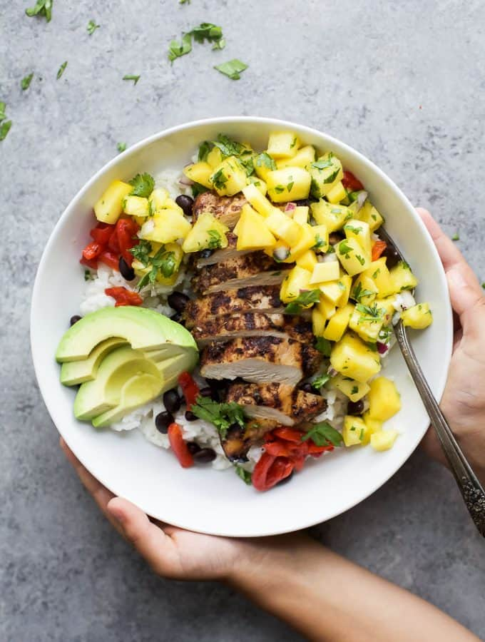 Head to Jamaica with this Grilled Jerk Chicken Bowls topped with Mango Pineapple Salsa served over Coconut Rice. An easy gluten free weeknight meal your family will love! | #ad @justbarechicken