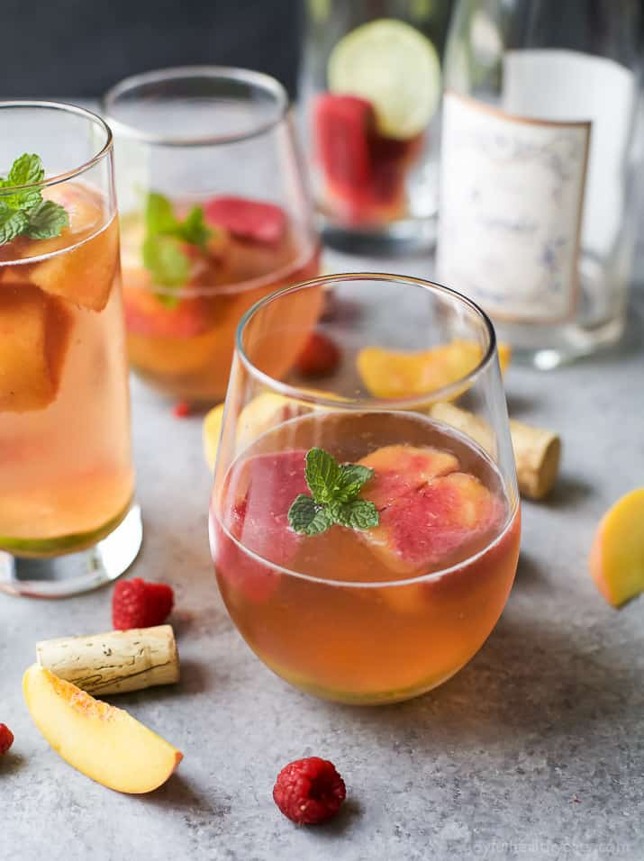 Rosé Wine with Homemade Fresh Fruit Cubes made with raspberries and peach - a perfect refreshing cocktail for the summer!