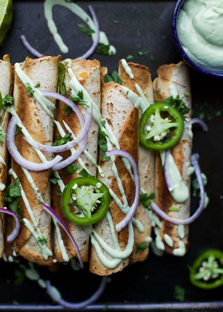 Cheesy Butternut Squash Chicken Taquitos drizzled with an Avocado Crema, a fun fall recipe the family will love. These chicken taquitos are made in 35 minutes and each serving is has 28 grams protein. #UndeniablyDairy #ad @DairyGood