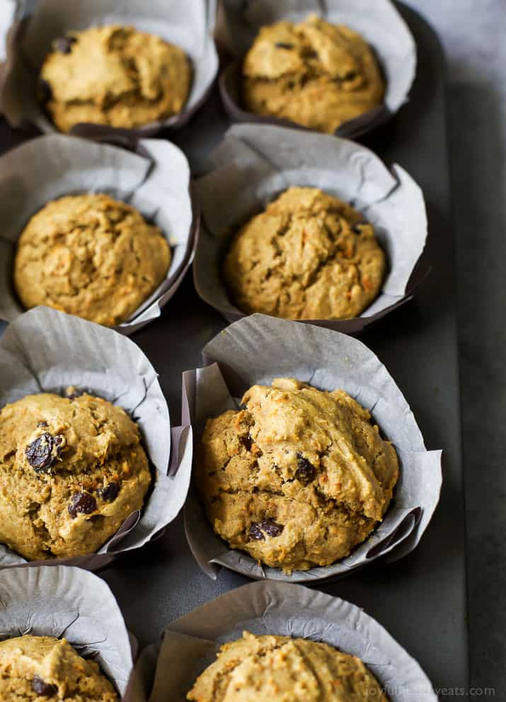 Healthy Carrot Cake Muffins with parchment liners in a muffin tin
