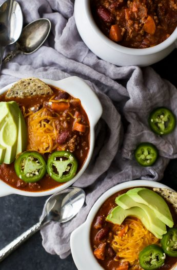 The ULTIMATE 30 Minute Beef Chili Recipe - perfectly spiced for a deep hearty chili taste you'll love. Filled with veggies, ground beef, rich spices, and kidney beans for the best chili bite! {paleo & gluten free}