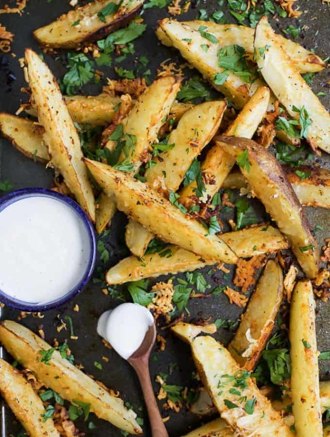 Garlic Parmesan seasoned Potato Wedges roasted in the oven until tender and crispy. These delicious potato wedges are guaranteed to be your new favorite appetizer or side dish!