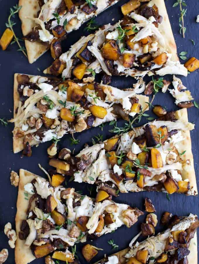 Butternut Squash Chicken Flatbread Pizza with balsamic caramelized onions and goat cheese. An easy pizza recipe that comes together in less than 30 minutes, or serve this as an appetizer at your next holiday party!