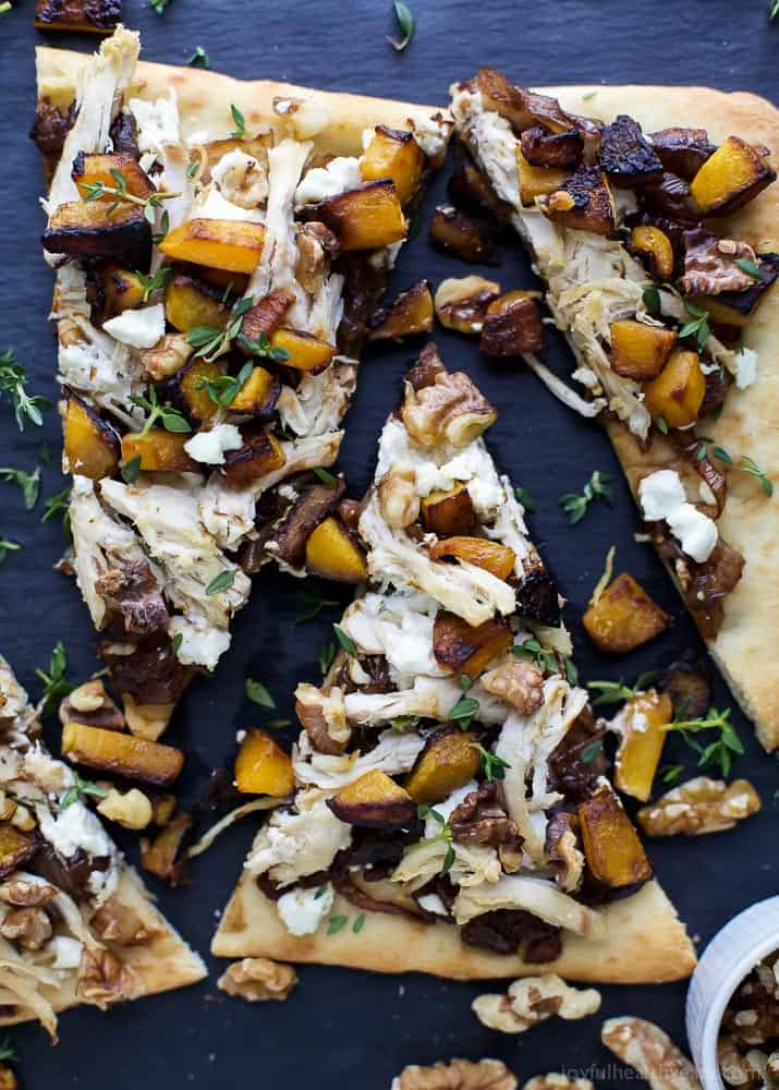Slices of Butternut Squash Chicken Flatbread Pizza with balsamic caramelized onions and goat cheese.