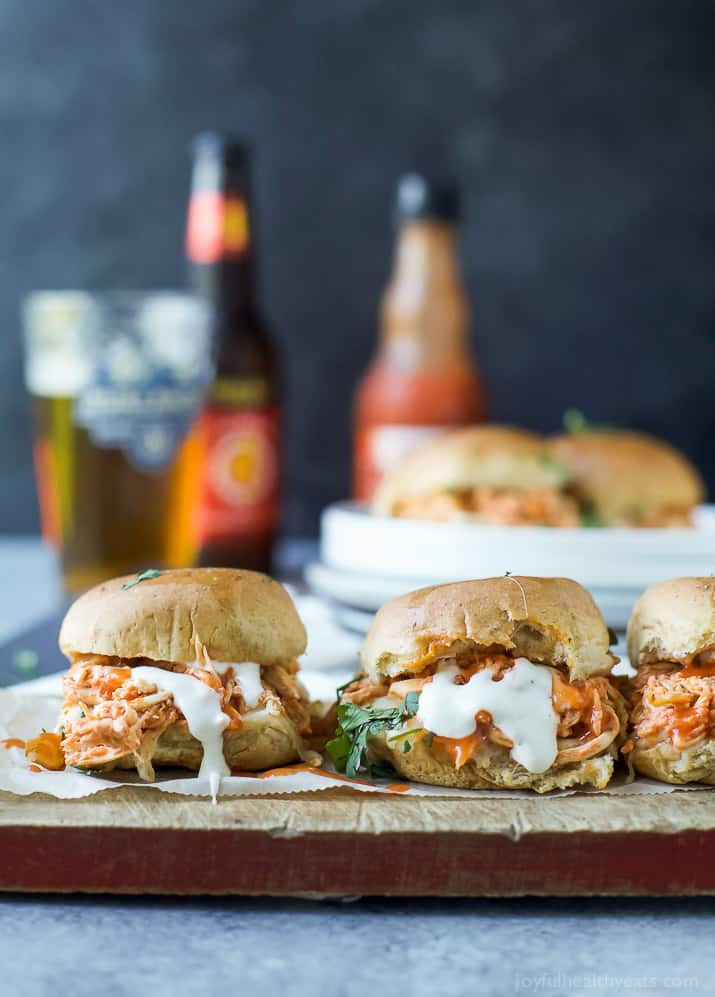 Baked Cheesy Buffalo Chicken Sliders made in less than 30 minutes and using only 5 ingredients! Loaded with Buffalo Chicken flavor these sliders are the perfect game day recipe!