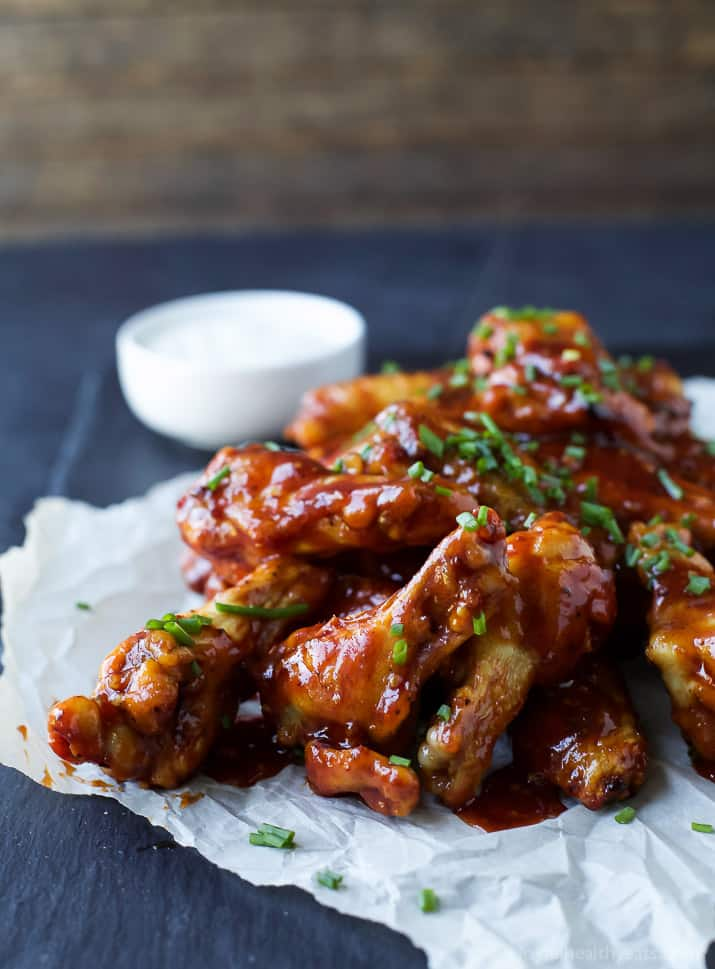 Baked Chicken Wings covered in a Honey BBQ Sauce with chives