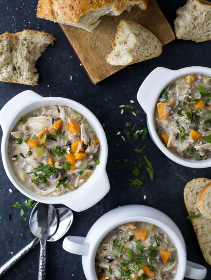 This Creamy Crock Pot Chicken and Wild Rice Soup is so easy to make and perfect for those cold winter nights with a slice of crunchy bread. This gluten free soup recipe is a must make and guaranteed to satisfy the whole family!