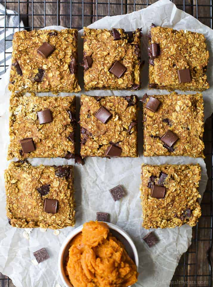 Oatmeal Chocolate Chip Pumpkin Bars - thick chewy oatmeal bars loaded with pumpkin flavor and melted chocolate in every bite. These Pumpkin Bars scream fall and are only 135 calories a serving! Perfect for the fall!