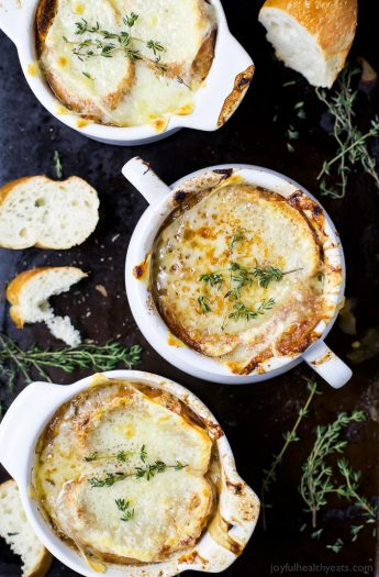 Top view of three bowls of bubbly Classic French Onion Soup