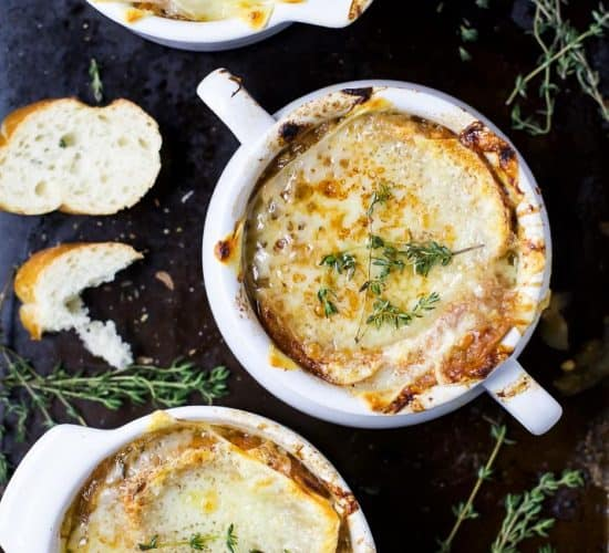 Easy Homemade FRENCH ONION SOUP - filled with caramelized onions and deep beef flavored then topped with gooey cheese! This French Onion Soup is a classic for the fall and sure to please any crowd!