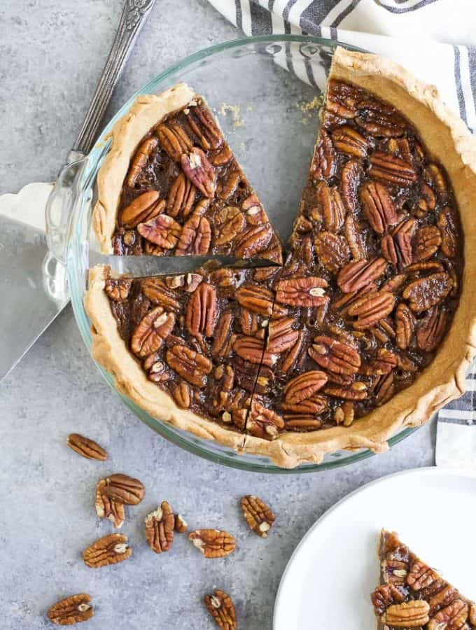 An easy & delicious Homemade Pecan Pie made without corn syrup! The perfect holiday dessert recipe that's sure to please even those Pecan Pie experts!