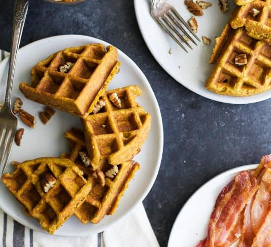 Crispy Moist Gluten Free Pumpkin Waffles made with oat flour, filled with pumpkin puree, pumpkin spice flavor then topped with a Vanilla Pecan Maple Syrup - the perfect fall breakfast!
