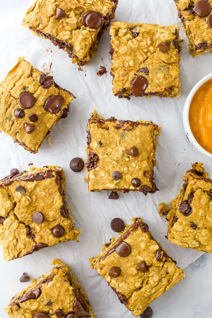pumpkin bars with chocolate spread out on a board with pumpkin puree