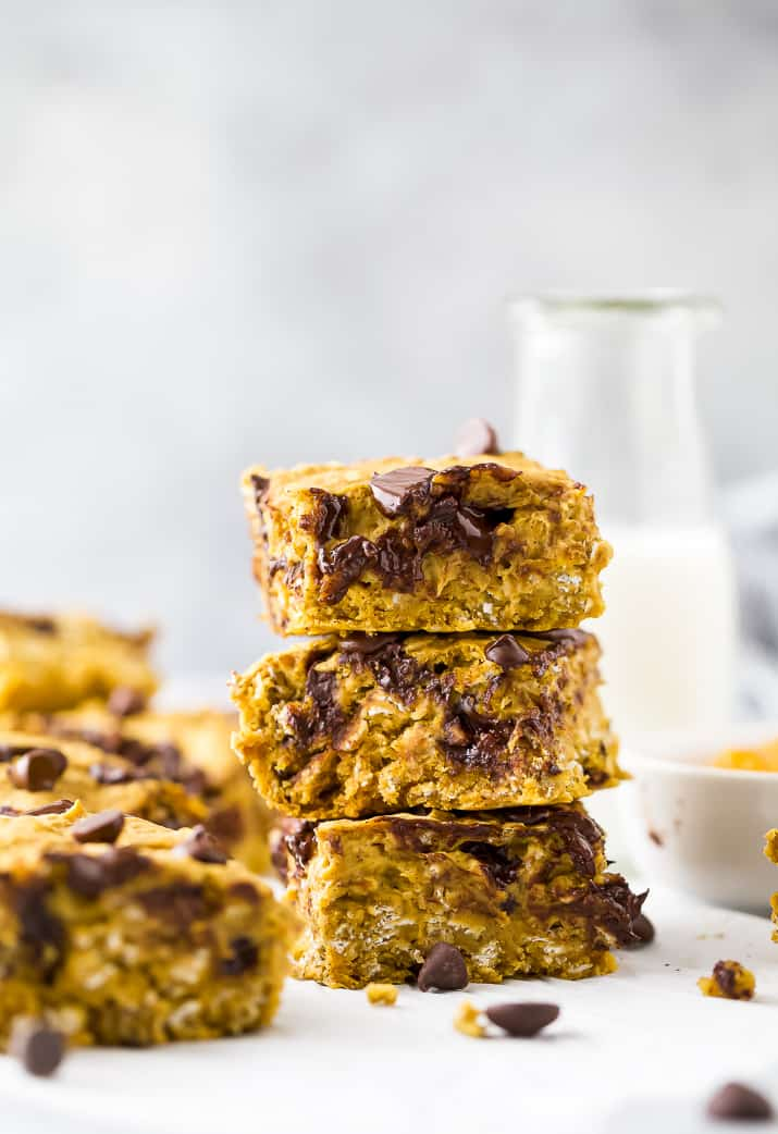 pumpkin bars with chocolate chips stacked on top of each other