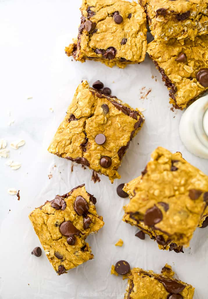 pumpkin oatmeal bars with chocolate chips on a board