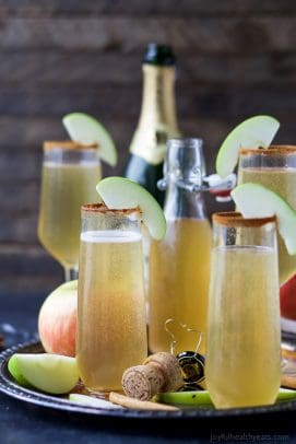 apple cider mimosas in a glass